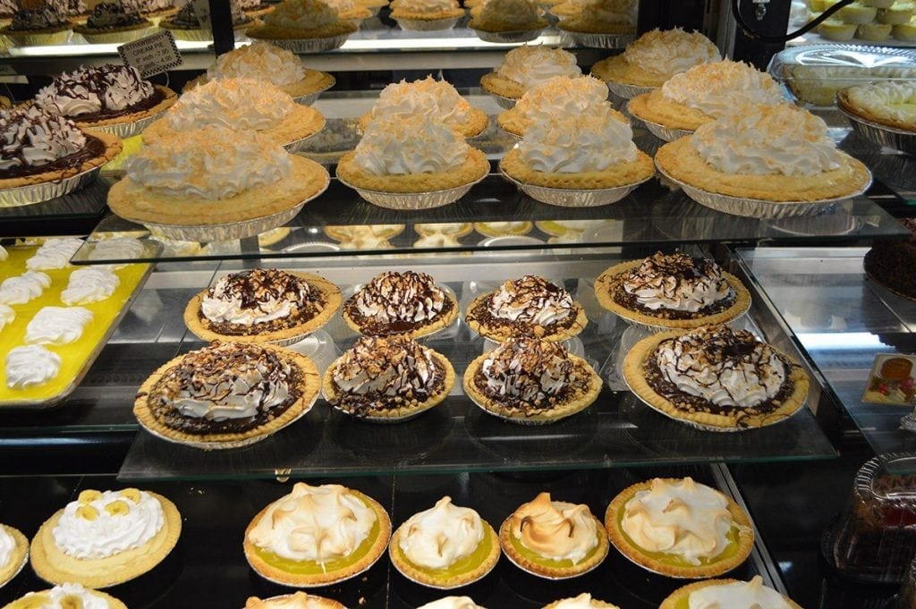 variety of pies in bakery case