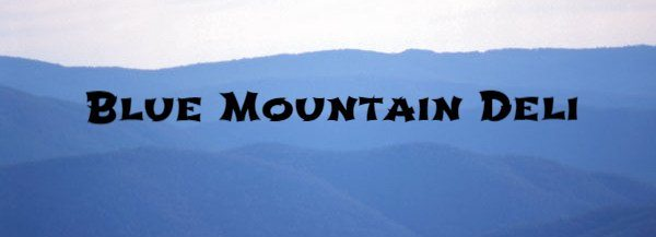 "logo of mountains with words ""Blue Mountain Deli"""
