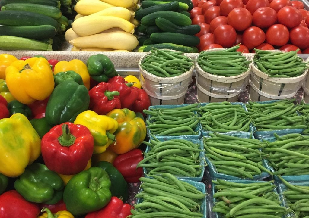 produce including green beans and bell peppers